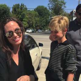 Angelina Jolie buys a giant teddy bear from a yard sale