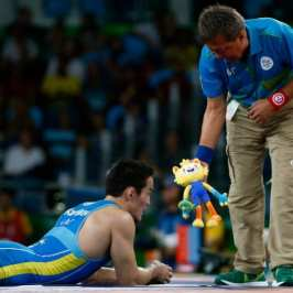 Here's why trainers are throwing stuffed animals onto the ring at the Olympic wrestling tournament