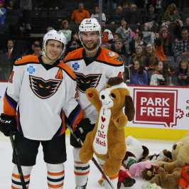 Watch two hockey teams which just held their Teddy Bear Toss events