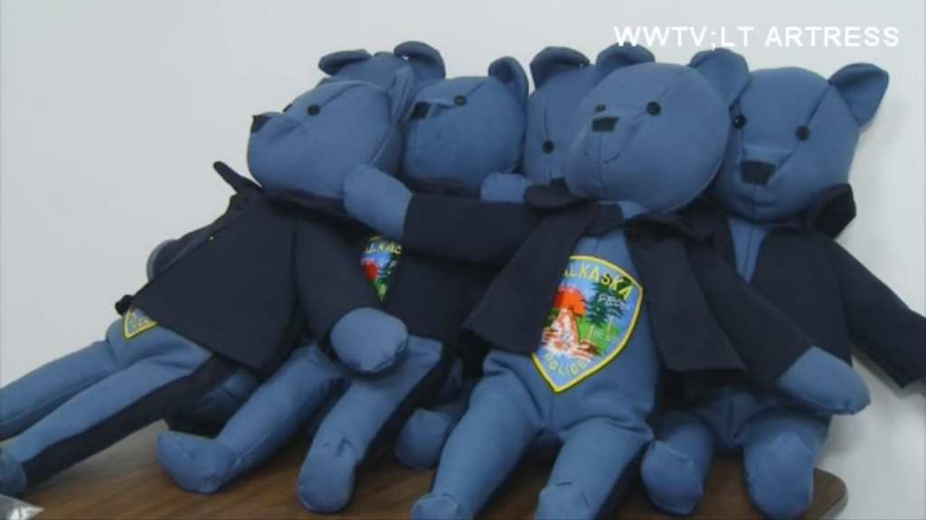A Michigan woman is making teddy bears out of retired police uniforms for kids