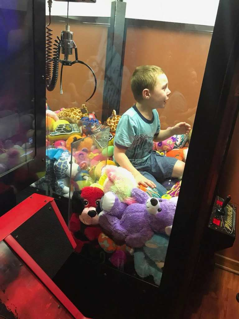 Young boy wanted a stuffed animal from a claw machine so much, he crawled in and got stuck in it